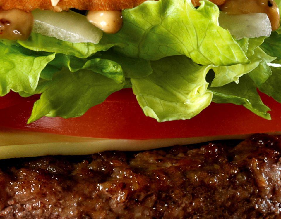 Close up of beef patty and salad
