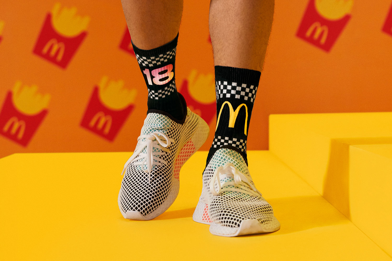 black socks with Joe Freshgoods number 18 and McDonald's logo in white mesh shoes