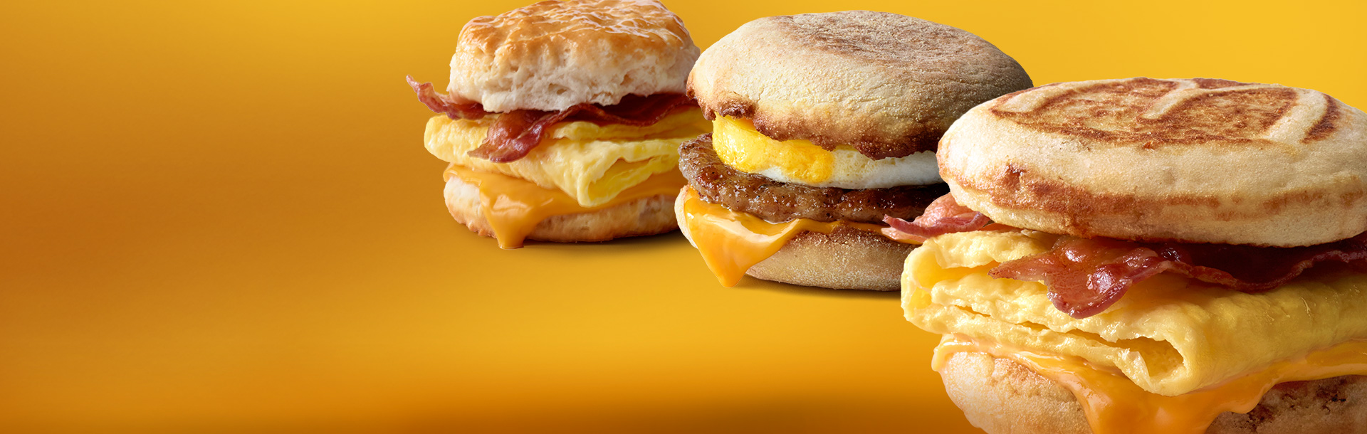 A Bacon, Egg & Cheese Biscuit, Sausage McMuffin® with Egg and Bacon, Egg & Cheese McGriddles®