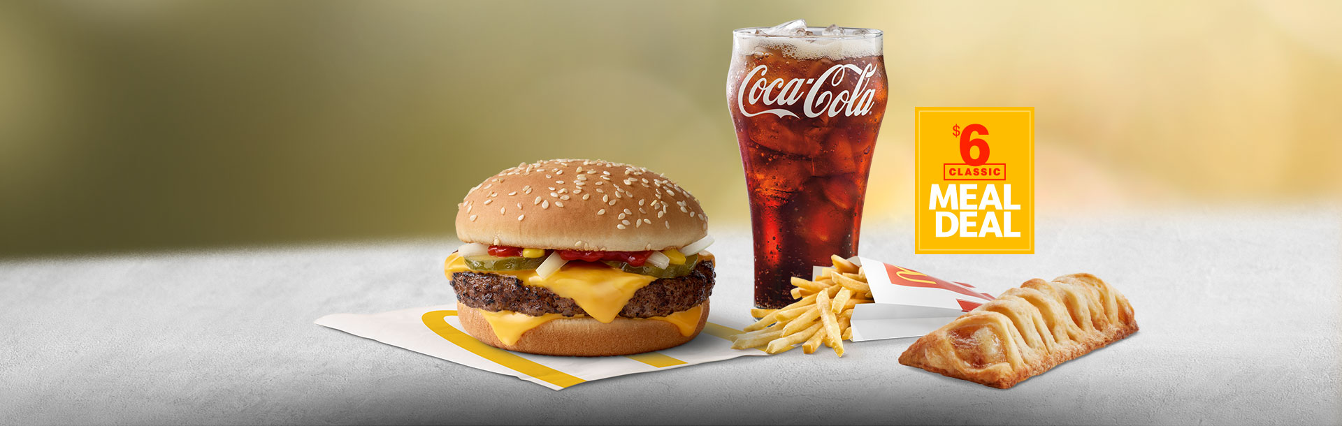 $6 Classic Meal Deal with Quarter Pounder with Cheese, Fries, Apple Pie, Coca-Cola