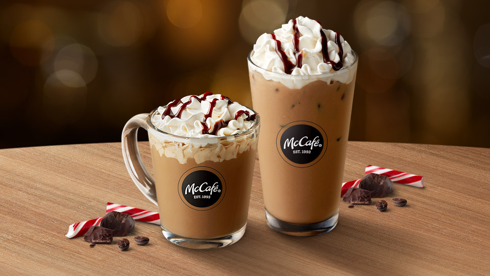 Hot and cold McCafé® Peppermint Mocha drinks in glassware