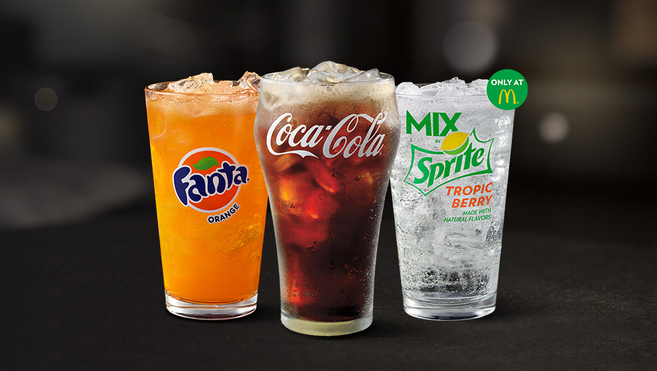 Fanta® Orange, Coca-Cola® and MIX by Sprite™ Tropic Berry in glassware with ice