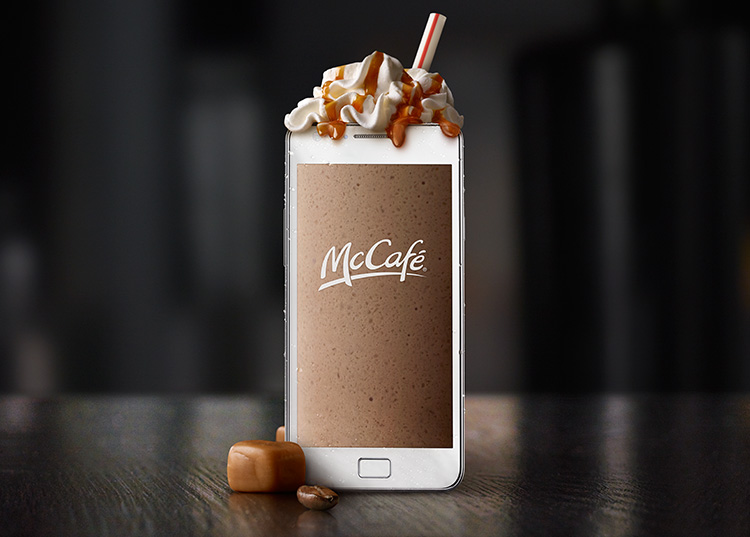 mobile phone that looks like a mccafe drink with whip cream, carame, and a straw.