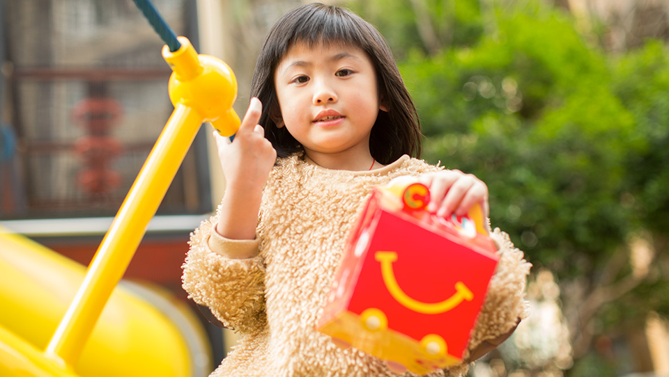 Girl with Happy Meal