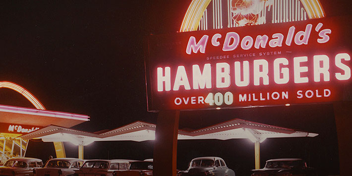 Neon sign and storefront of early McDonald's restaurant
