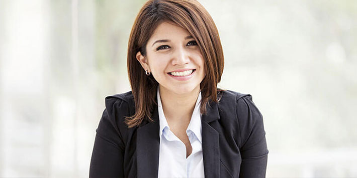 Young woman in business casual attire smiling