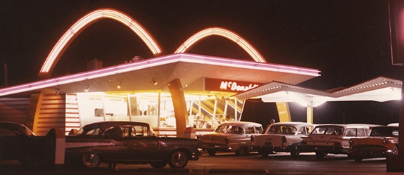 McDonald's first restaurant with multiple cars parked outside