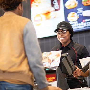staff taking customer's order at mcdonald's