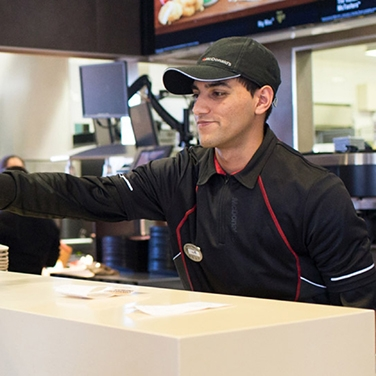 mcdonald's staff serving food over the counter